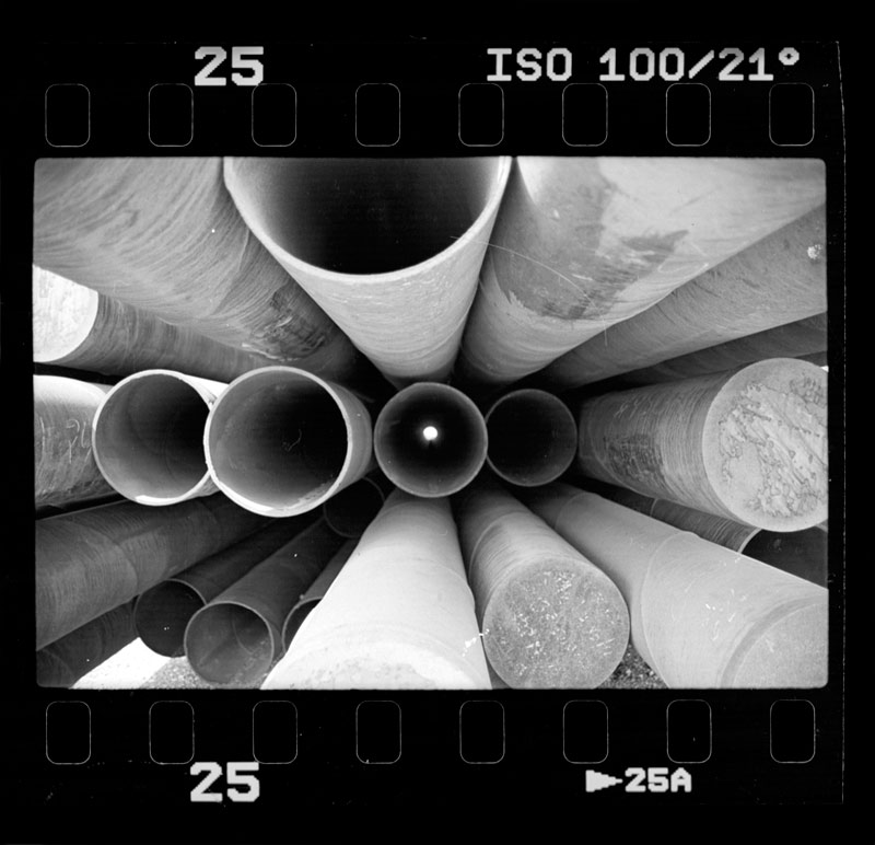 A set of pipes from a industrial yard on film