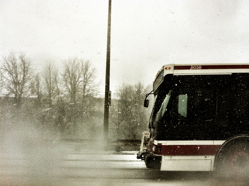 A public transit bus in Toronto, Canada during a massive snow store in 2013