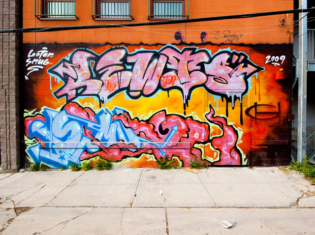 Toronto street graffiti by Smug and Looter.