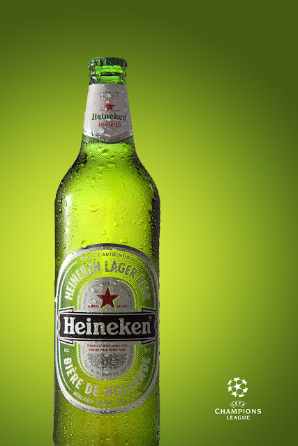 A Heineken Beer on a Green background with a Champions League logo.