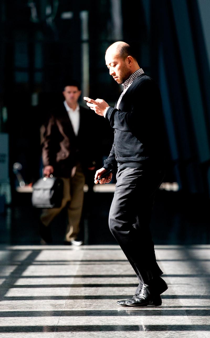 A businessman checks his text messages