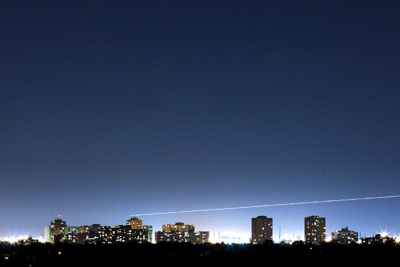 A plane over Dixon caught in a long exposure