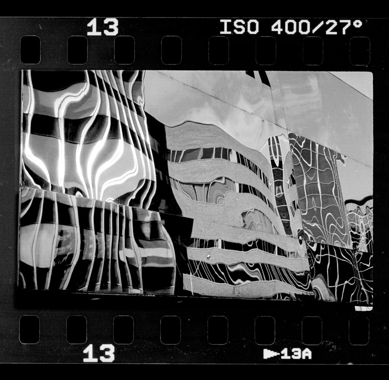 A full frame image 35mm of reflections on glass. AGFA APX 400