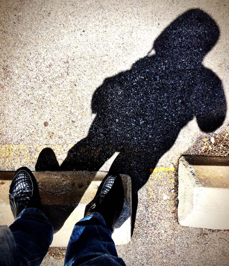A person and their shadow on concrete shot by Dennis Marciniak of denMAR Photography