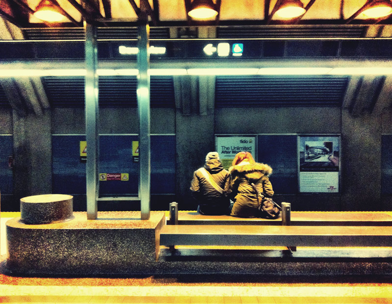 A couple waiting for the train at downsview station in Toronto Ontario Canada