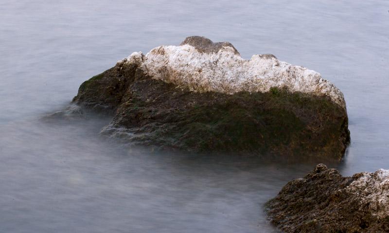 Water hitting a rock