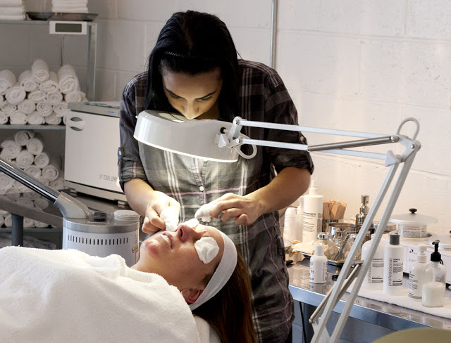 A woman getting a facial