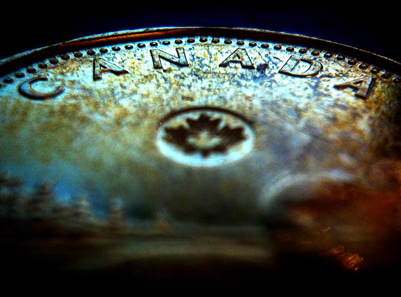 A macro shot of a Loonie shot with the iPhone 4 focused on the Canada signage