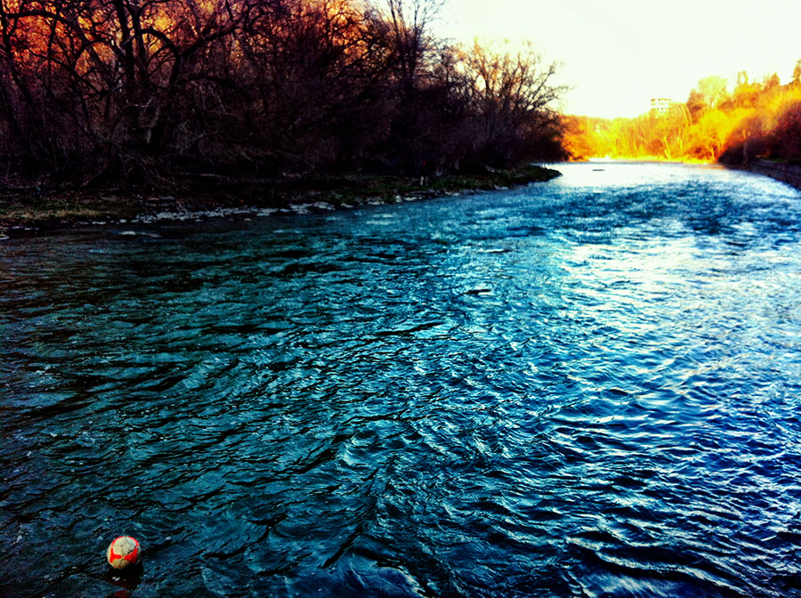 A lost soccer ball floats down the river in Canada
