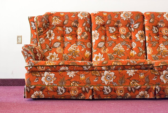 A very classic 1970s couch. Straight from the era, not a replica.