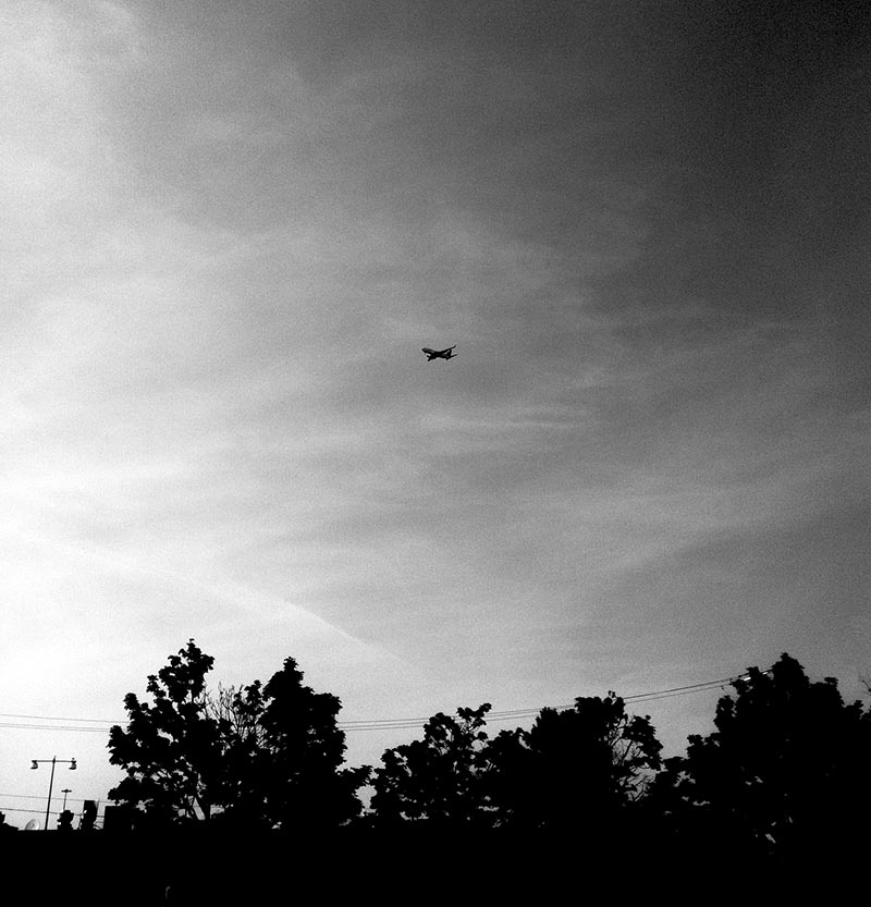 A plane flying in Canada in BW