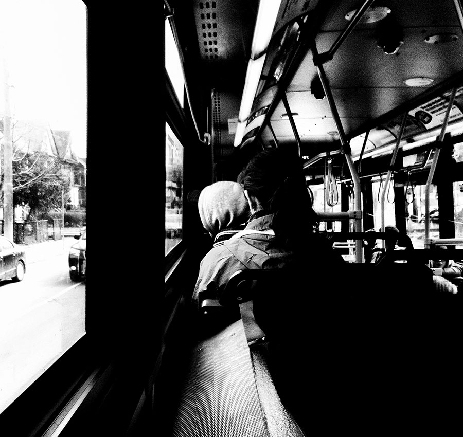 A man sits on the bus as he waits for to get off in Toronto Canada on the TTC