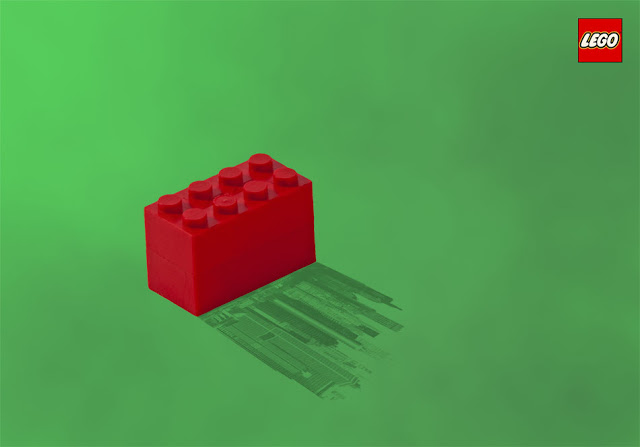 A Lego Advertisement of a block casting a cityscape shadow