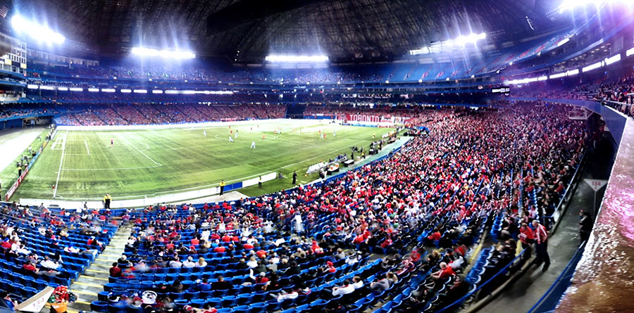 Toronto FC play against Sporting Kansas City in the MLS in 2013 at the home opener in Toronto Ontario Cnada in the SkyDome stadium also known as the Rogers Centre