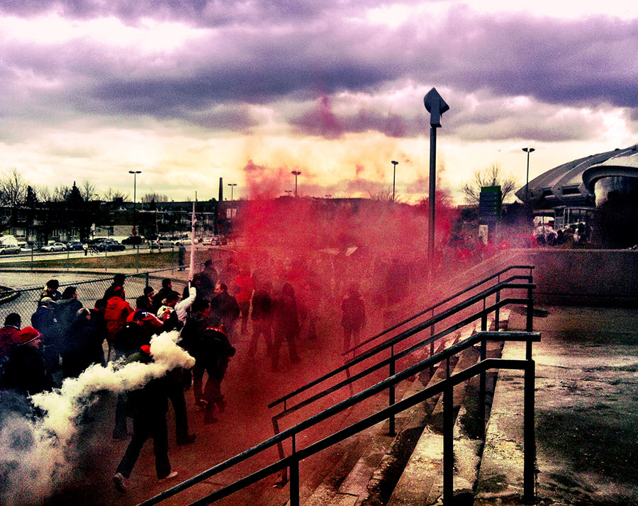 Toronto FC fans light smoke on the way to the March to the match in Montreal at Stade Olympique in Quebec. Match was played on March 16 2013