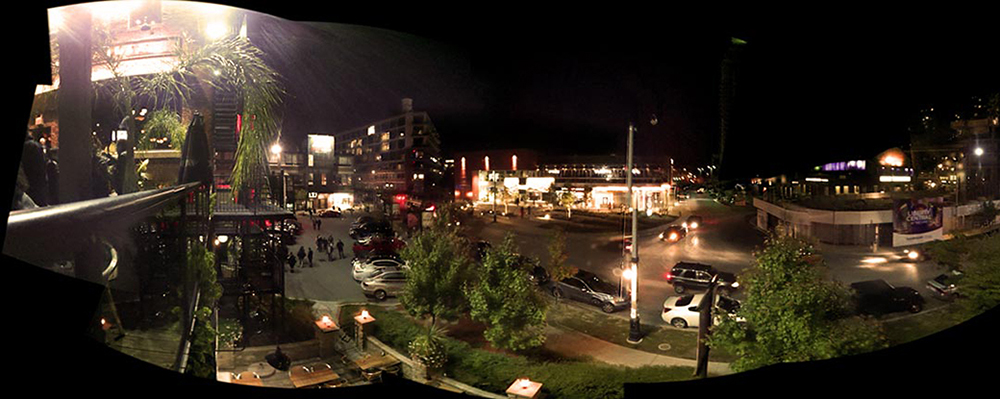 A panorama of the brazen head bar in liberty village in toronto ontario canada at night