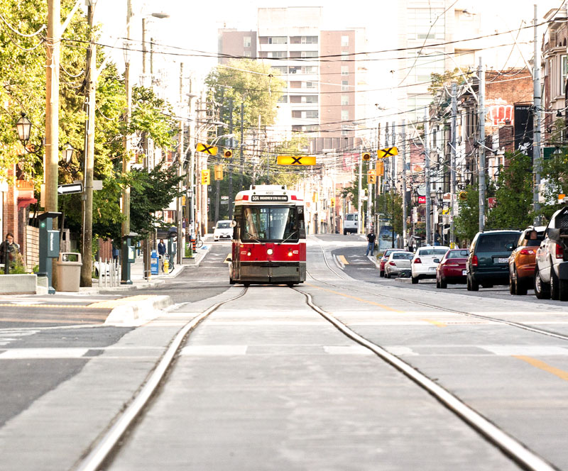 A TTC Street car moving down Roncesvalles.