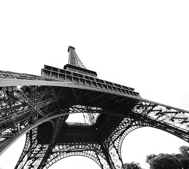 Underneath the Eiffel Tower, a shot in black and white done by Dennis Maricniak