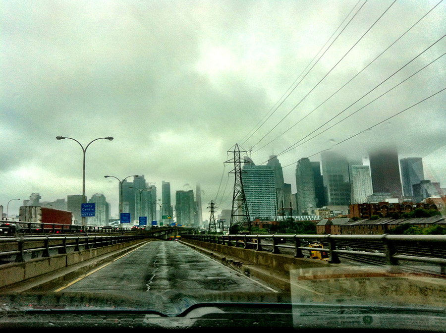 Entering the Gardner Expressway onramp in the rain, in Toronto