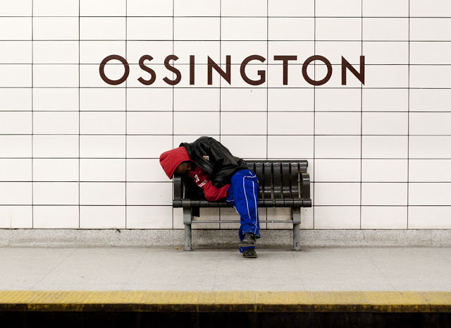 A man sleeps at Ossington Station