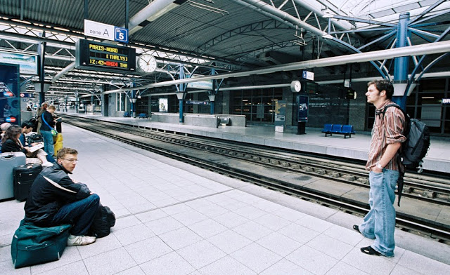 Two men waiting for a train at Brussles midi