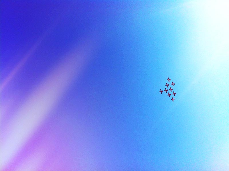 Airplanes in formation flying overhead in an instagram filter shot an iPhone 4 at the 2012 CNE Airshow in Toronto Ontario