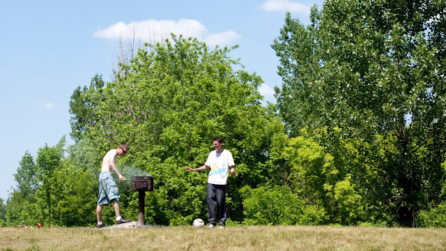 Two men in their early twenties BBQing at James Garden in Toronto.