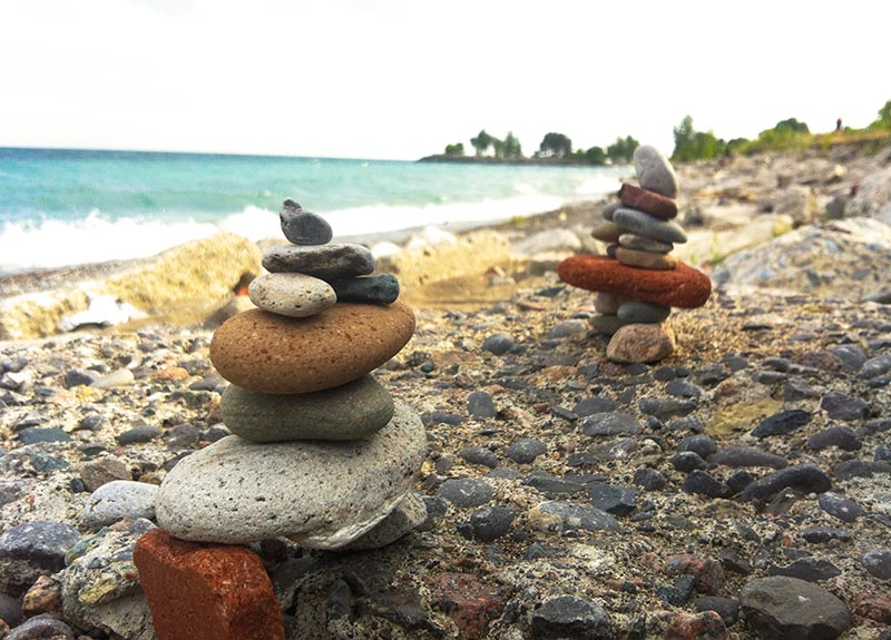 A bunch of rocks by Lake Ontario built like a rock tower in Toronto Canada near Humber Bay Park