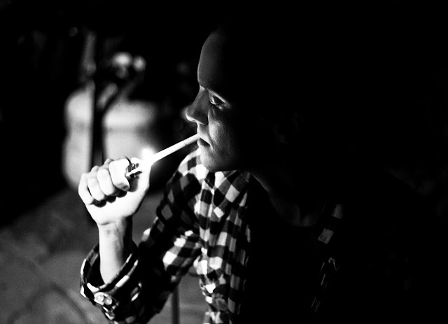 Lindsay smoking a cigarette at the Rabbit Hole.