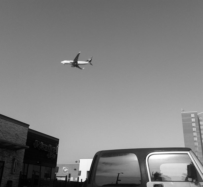 Plane over Parking Lot near Pearson Airport in Toronto Ontario Canada