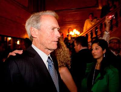 Clint Eastwood rushing past cameras