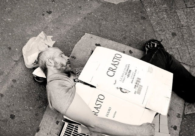 A homeless man sleeps on the downtown streets of Toronto