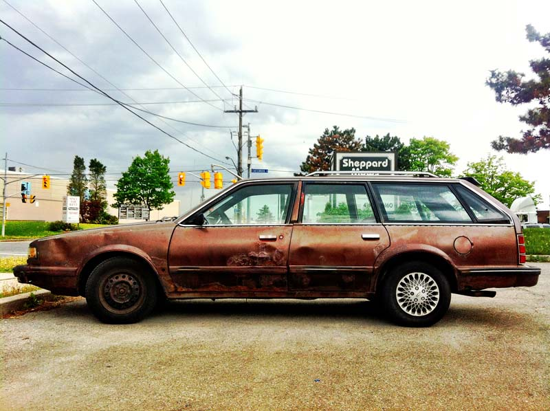 A rusted car shot by Dennis Marciniak of denMAR Photography with an iPhone