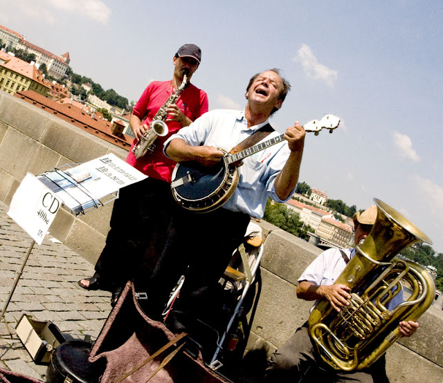 A street band playing their music on a bridge in Praha, Prague