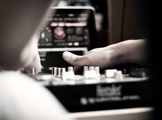 A DJ mixing on a Hercules mixer.