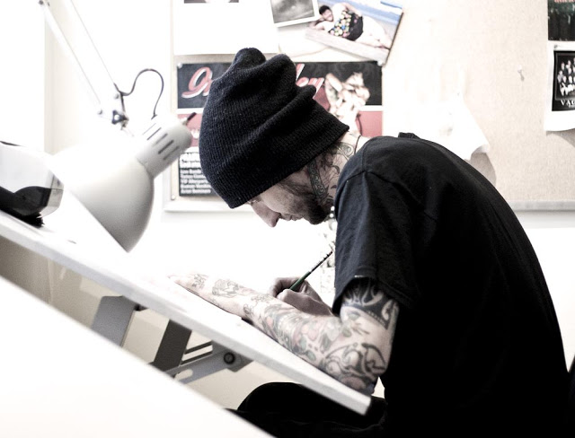 One of the artists sketching at Imperial Tattoo in Toronto