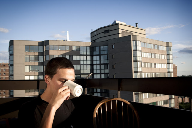 A man enjoys a coffee high up in the sky