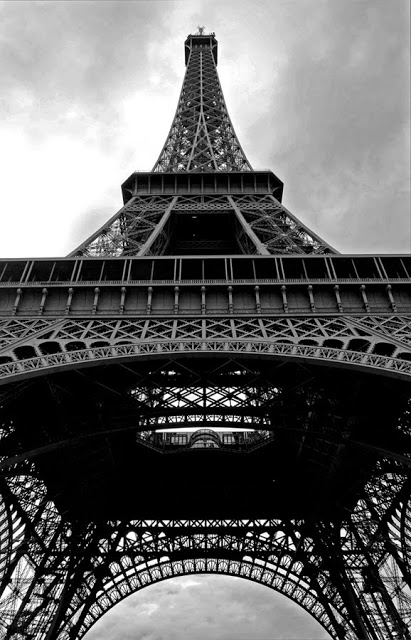 Look up at the Eiffel Tower in black and white