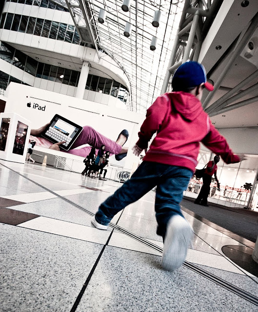 A child running through the Eaton Centre at the North Entrance