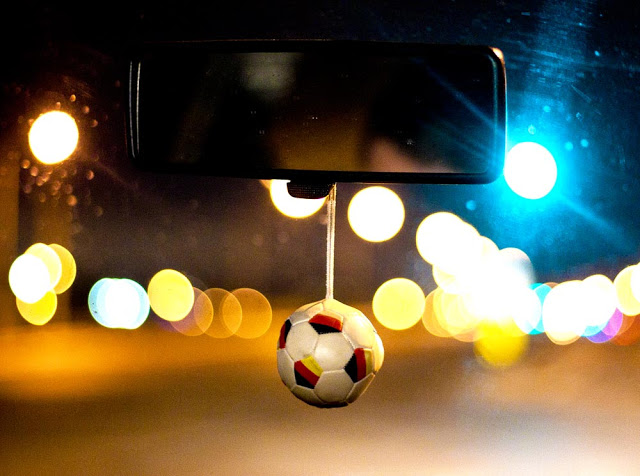 Soccer ball dangling from a mirror