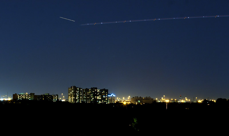 A plane streak from an airoplane landing at Toronto's Pearson Airport