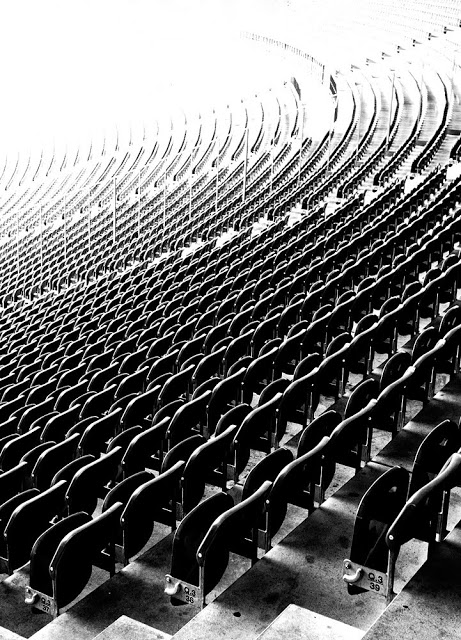 Berlin's Olympic Stadium seating in black and white shot by Dennis Marciniak