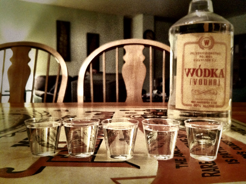 Five shots of vodka laid out for consumption by friends