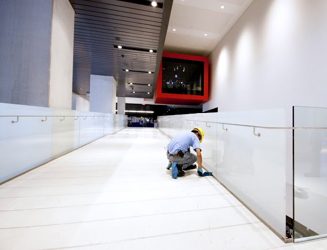A construction worker putting in the final preparations at the TIFF Bell Lightbox in Toronto
