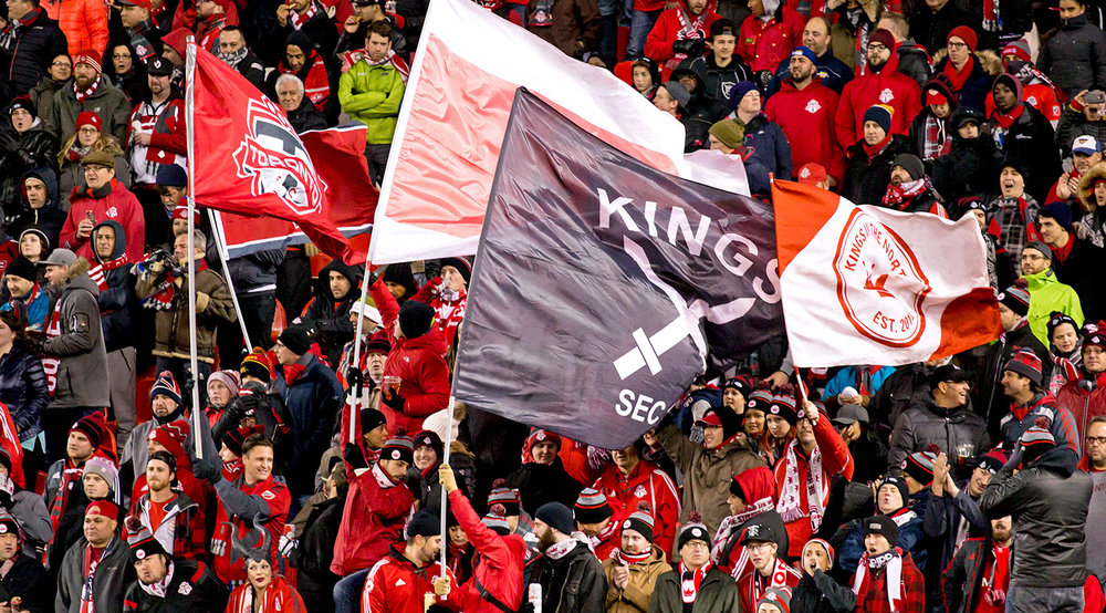 Kings of the North hold their flags in the south end at BMO Field during the first ever eastern conference semi final game. Photo by Dennis Marciniak of denMAR Media.