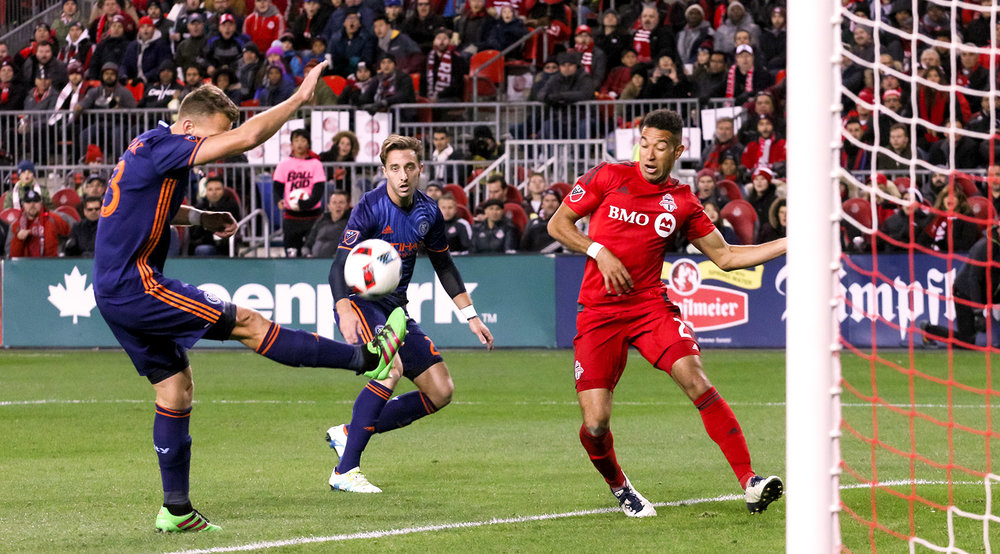 A NYCFC defender clears the ball in their 18 yard box during Toronto FC's biggest match to date. Photo by Dennis Marciniak of denMAR Media.