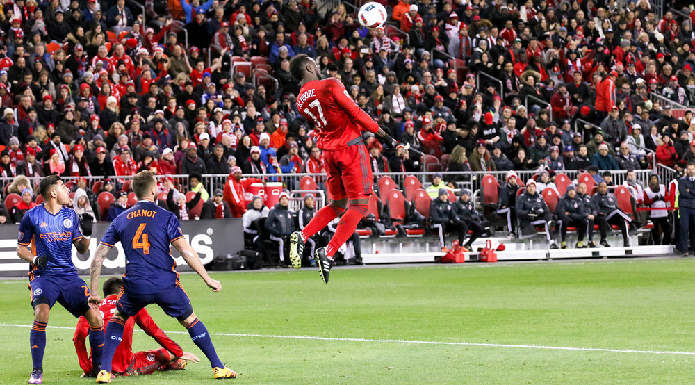 Jozy Altidore leaps into the air for a header during a 2016 MLS playoff game at BMO Field. Photo by Dennis Marciniak of denMAR Media.