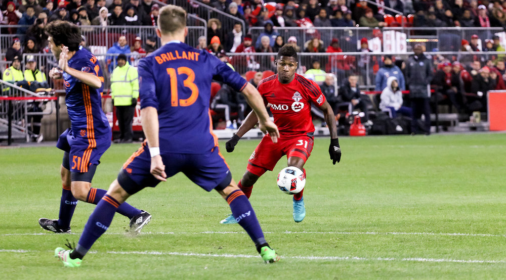 Armando Cooper looks to play the ball into space during a 2016 MLS playoff game at BMO Field. Photo by Dennis Marciniak of denMAR Media.