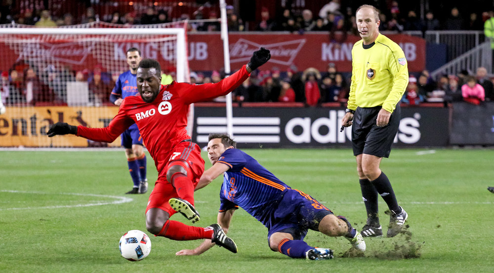 Jozy Altidore is taken to the ground by a NYCFC defender during a 2016 MLS Cup Playoff game. Photo by Dennis Marciniak of denMAR Media.