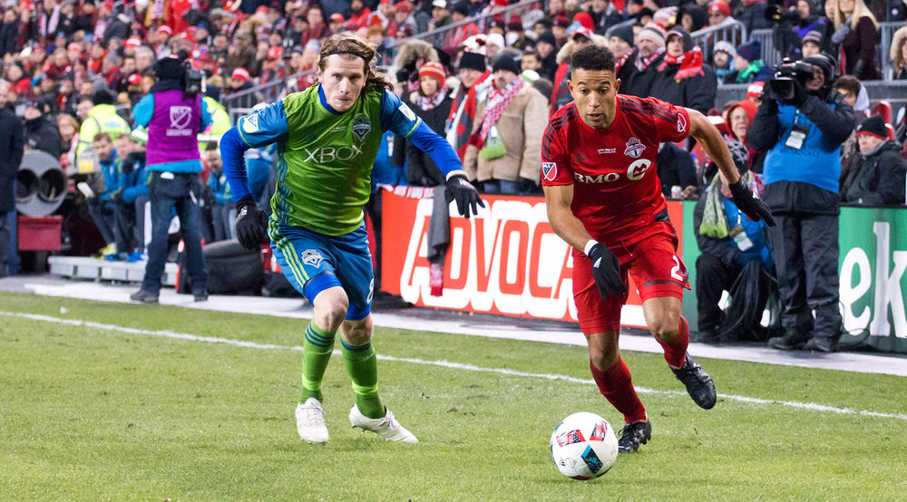 Justin Morrow and Erik Freiberg go after the ball in the north end of BMO Field at the 2016 MLS Cup Final. Image by Dennis Marciniak.